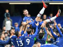 Gary Cahill is held aloft by the Chelsea squad as the defender leaves Chelsea.  AFP