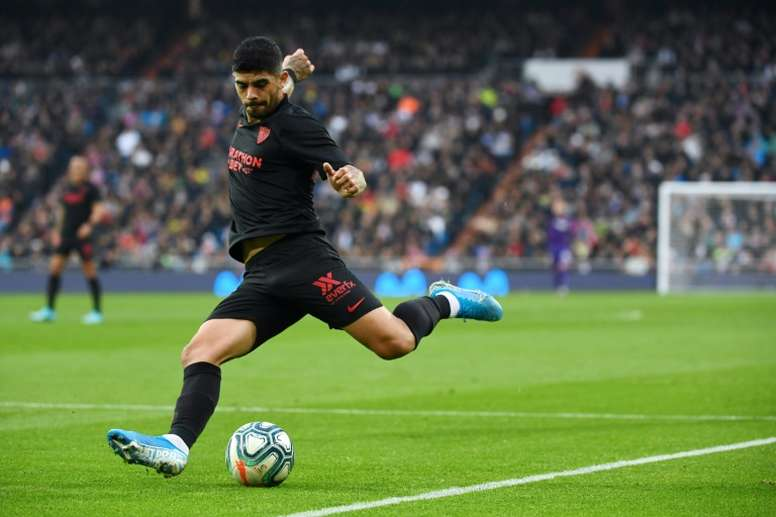 Banega has reached an agreement with Sevilla to stay until the end of August. AFP