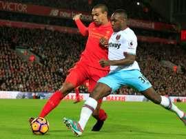 Le défenseur de Liverpool Joël Matip à la lutte avec le milieu de West Ham Michail Antonio. AFP