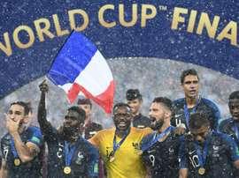 Les joueurs de l'équipe de France fêtent leur victoire en finale du Mondial. AFP