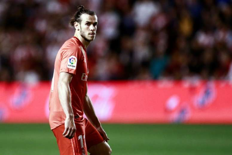 Bale's summer is bound to be complicated. AFP