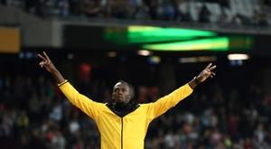 La star du sprint, le Jamaïcain Usain Bolt, lors de son tour d'honneur aux Mondiaux, le 13 août 2017 à Londres