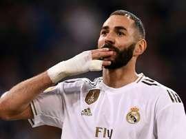 Juninho rêve de voir revenir Benzema. AFP