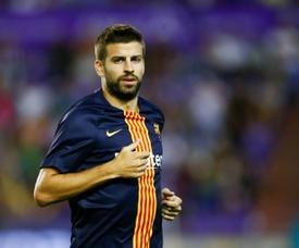 Piqué mandó sus ánimos a Messi. AFP