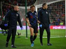 Modric souffre d'une contusion à la jambe droite. AFP