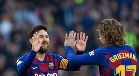 Lionel Messi e Antoine Griezmann estão pendurados na Champions League. AFP