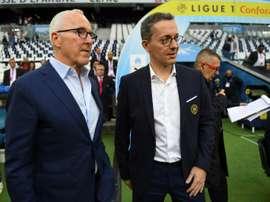 Frank McCourt et Jacques-Henri Eyraud lors du match de Ligue 1 contre Montpellier. AFP