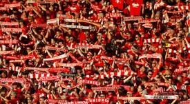 La hinchada del Union Berlin literalmente sangró para salvar al club. AFP/Archivo