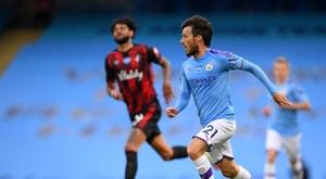 David Silva porte Manchester City. AFP