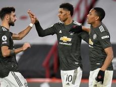 Manchester United déroule et revient dans la course. AFP