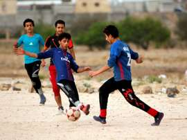 Le football en milieu des conflits. AFP