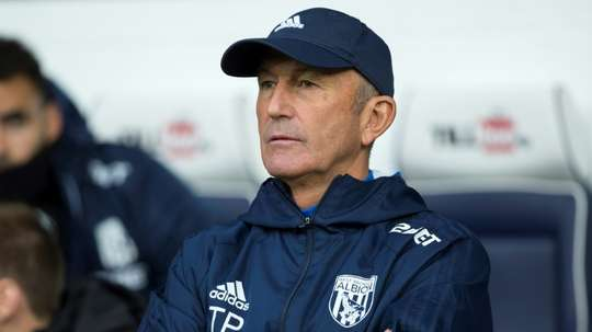 Tony Pulis is possibly lucky to be alive after Dave Kitson attacked him. AFP