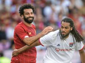 Mohamed Salah et Jason Denayer lors d'un match amical. AFP
