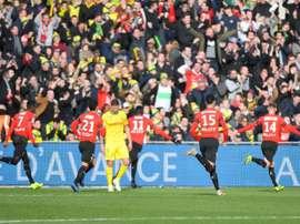 Les joueurs du Stade rennais communient avec leur supporters. AFP