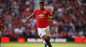 O United fica no quase contra o Liverpool. AFP