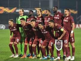 El Cluj consiguió un punto en casa para seguir líder. AFP