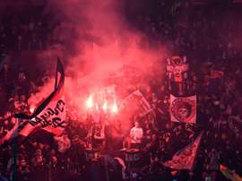 PSG supporters set off flairs during their side's clash with Real. AFP