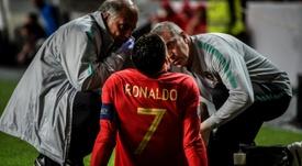 Cristiano se lesionó ante Serbia. AFP