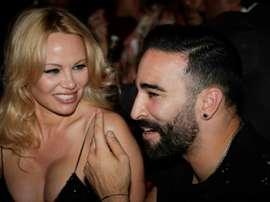 L'actrice américaine Pamela Anderson et le footballeur marseillais Adil Rami. AFP