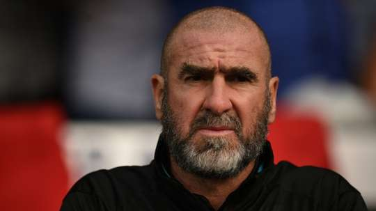Cantona was reluctant to admit it. AFP