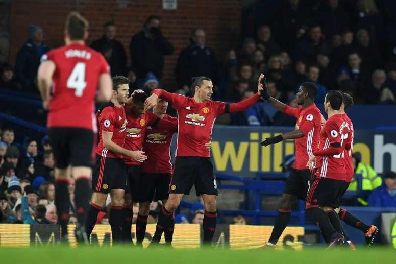 United celebrating a goal. AFP