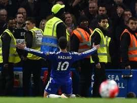 Hazard celebrates scoring against Tottenham last season. AFP