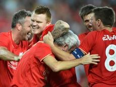 John Arne Riise (2g), alors défenseur de Liverpool, en joie avec ses coéquipiers après un but des Reds en match exhibtion contre une sélection australienne à Sydney, le 7 janvier 2016