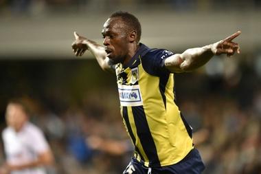 Bolt celebrates scoring for Central Coast Mariners in October. AFP