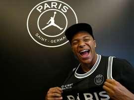 O PSG prepara um novo contrato para Mbappe. AFP