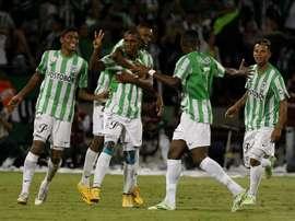 Jugadores de Atlético Nacional celebran tras anotar un gol. EFE/Archivo