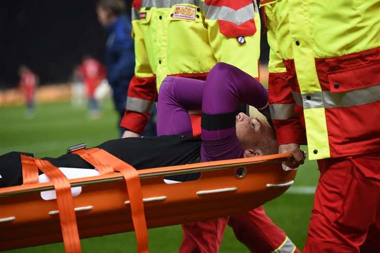 Butland gets taking away on a stretcher. AFP
