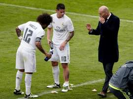 Marcelo and James talking to Zidane. AFP