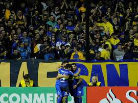Carlos Tevez  celebrates a goal for Boca Juniors against Deportivo Cali. EFE