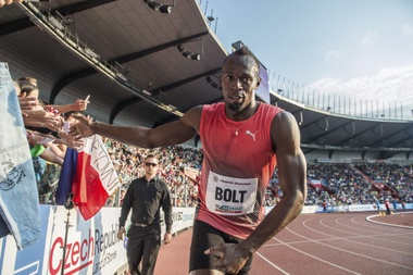 El plusmarquista mundial de 100 y 200 metros se retiró a principios de mes del campeonato de Jamaica por una lesión muscular que hizo dudar de su participación en Brasil. EFE/Archivo