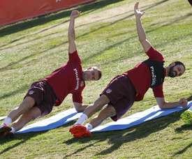 Dois dos mais antigos jogadores do atual plantel 'rojiblanco': Gabi e Juanfran. EFE