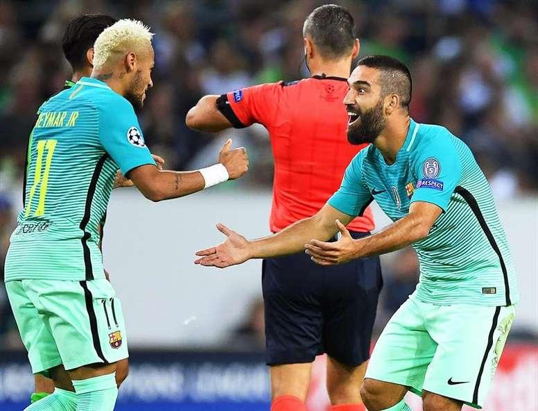 Neymar and Arda Turan celebrating a goal. AFP