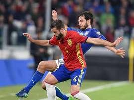 Spain's Nacho battling for the ball. EFE