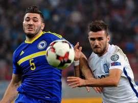 Grecia y Bosnia se repartieron los puntos en este bronco partido. EFE