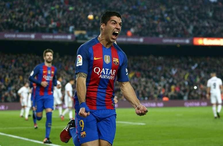 Suarez celebrating a goal. AFP