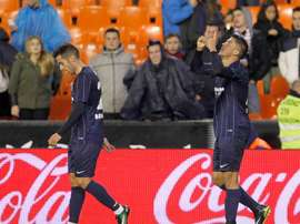 Le milieu du Malaga célèbrent un but contre Valence en Liga. AFP
