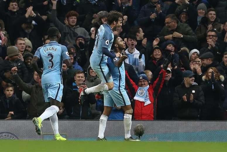 City players celebrating a goal. AFP