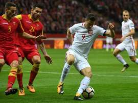 Poland qualify with hard-fought win. EFE
