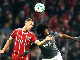 Bayern Munich's Joshua Kimmich (L) in action against Augsburg's Caiuby (R) during the German Bundesliga soccer match between Bayern Munich and FC Augsburg in Munich, Germany. EFE/EPA