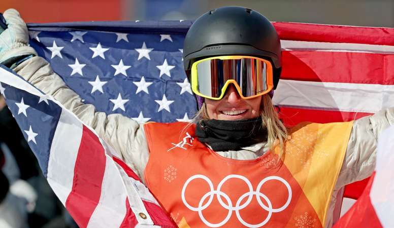 Gold medal winner Jamie Anderson of the USA celebrates her win with the US flag after the Womens Snowboard Slopestyle Final Run at the Bokwang Phoenix Park during the PyeongChang 2018 Olympic Games, South Korea, 12 February 2018. EFE
