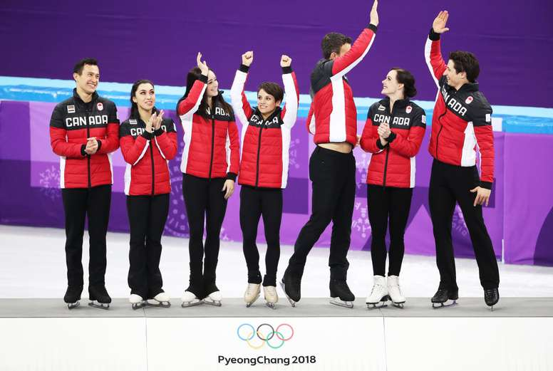 Team Canada (from left) Patrick Chan, Gabrielle Daleman, Kaetlyn Osmond, Meagan Duhamel, Eric Radford, Tessa Virtue and Scott Moir wave during the venue ceremony after winning the Figure Skating Team Event competition at the Gangneung Ice Arena during the PyeongChang 2018 Olympic Games, South Korea, 12 February 2018. EFE