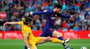 Filipe Luis e Messi são adversários de longa data. EFE
