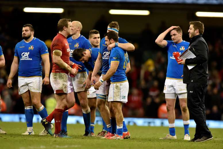 Italian players comfort each other in defeat against Wales at todays round 4 Six Nations rugby match between Wales and Italy at the Principality stadium, Cardiff, Wales, Britain. EFE