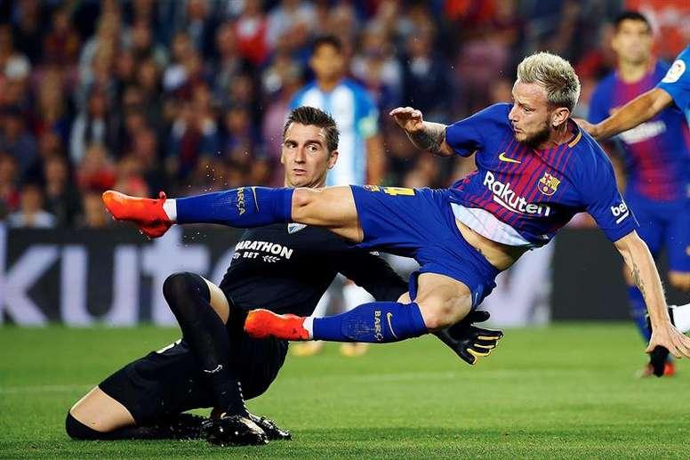 Le PSG et Monaco s'intéressent à Rakitic. AFP