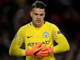 Ederson looked defeated as he conceded a second goal against Lyon. EFE
