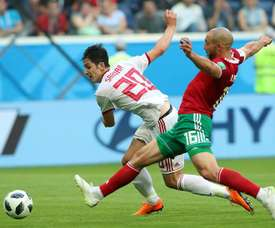 Sardar Azmoun will retire from international duty due to the effects on his family. AFP